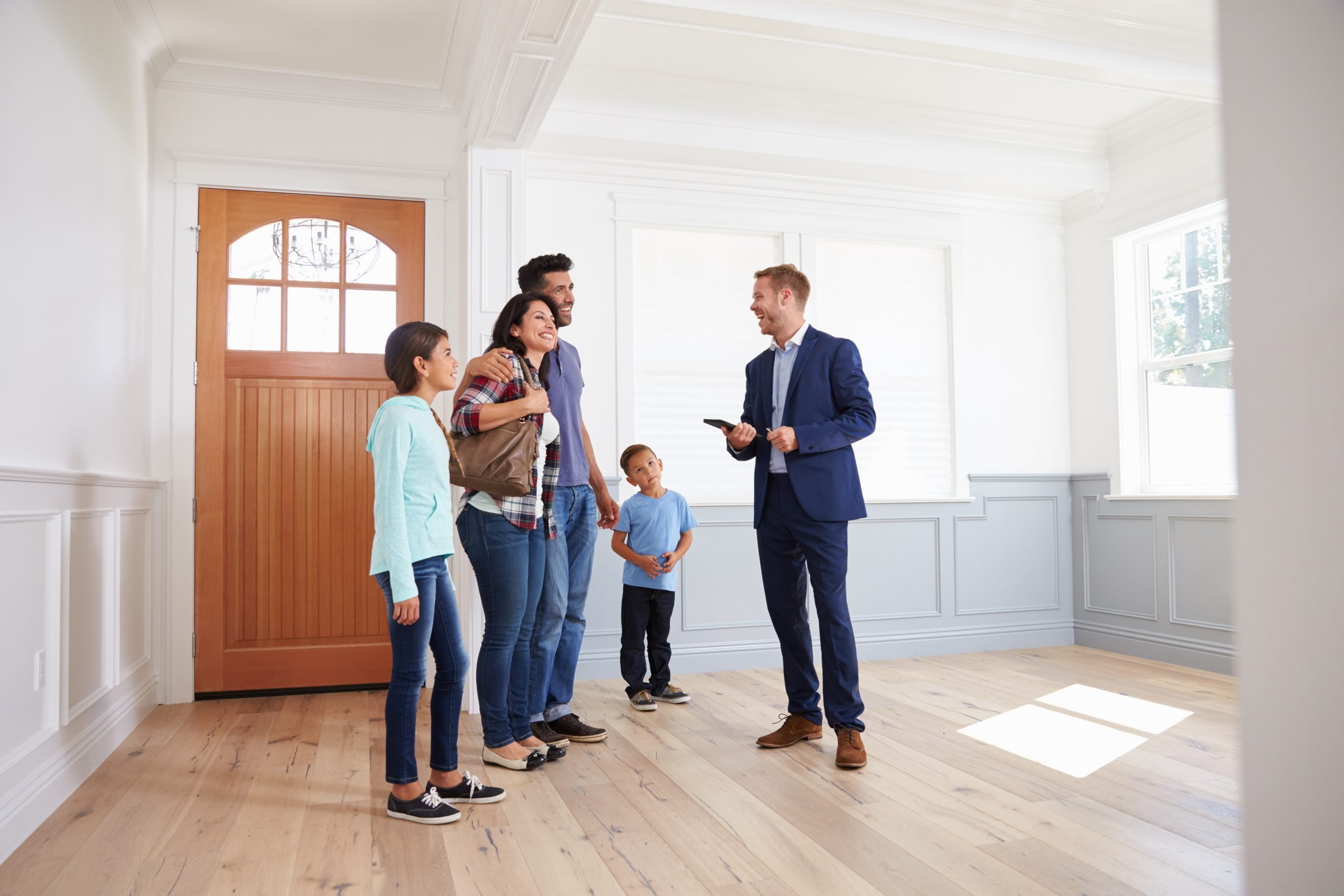 agent advising family about insurance quote before buying house